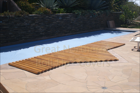 <p>Custom built Great Northern insulating Western Red Cedar Roll-Up&Acirc;&reg; Cover on an in-ground spa with flagstone deck</p>