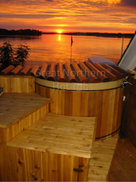 <p>Soaking in a Great Northern&reg; Rubadub Tub&reg; with the sunrise on Lake Minnetonka in the background is a great way to start the day</p>