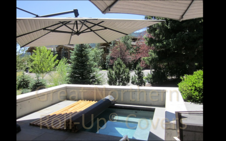 <p>Custom built Great Northern Western Red Cedar Roll-Up&reg; Cover on an inground gunite spa</p>
