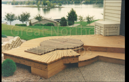 <p>Radial Deck surrounding sunken cedar Rubadub Tub&reg; hot tub. The extended tail Roll-Up&reg; cover rolls past the tub edge for more usable deck area while inside the tub.</p>