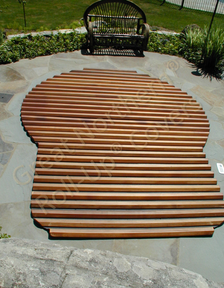 <p>Great Northern custom built rolling cedar wood hot tub cover for in-ground spa</p>