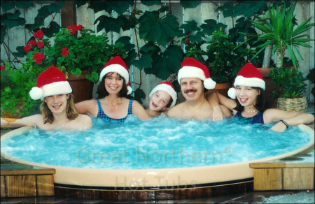 <p>Family enjoying a soak in a Great Northern&reg; Hot Tub on Christmas day</p>