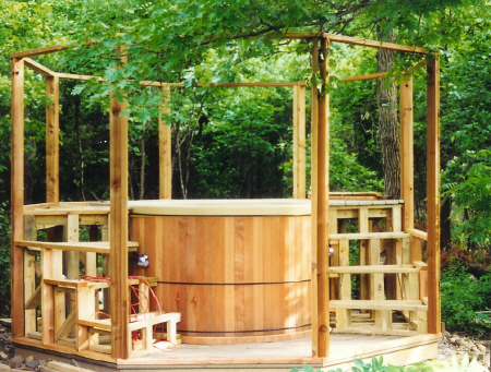 Creative Do-it-yourself project incorporating the Rubadub Tub® round wooden hot tub in a custom Gazebo w/steps, a work-in-progress.