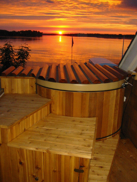 Soaking in a Great Northern® Rubadub Tub® with the sunrise on Lake Minnetonka in the background is a great way to start the day