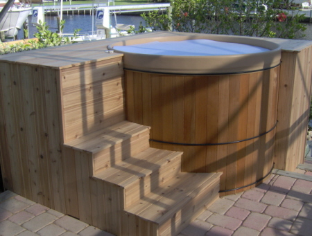 rubadub tub round wooden tub in a free standing portable deck