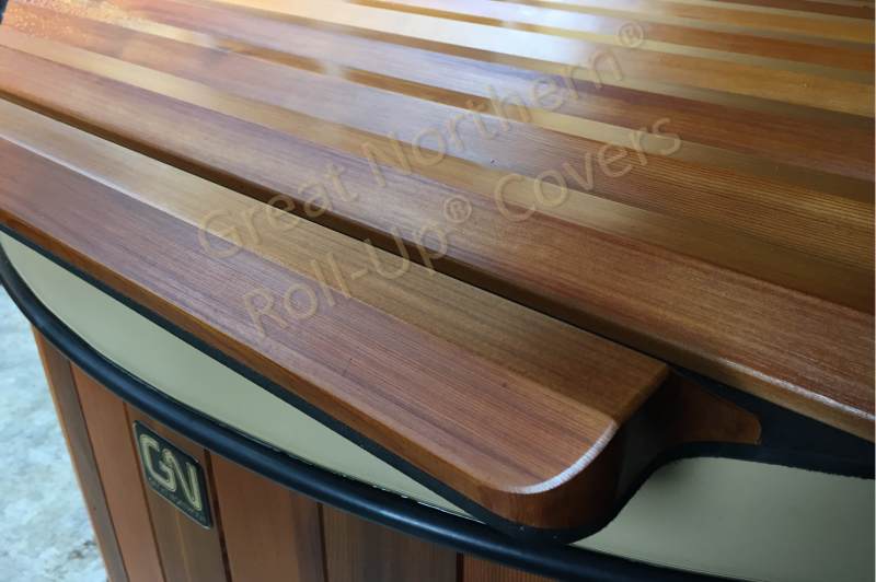 <p>Close up view of a unique solid wood roll-up spa cover.</p>
