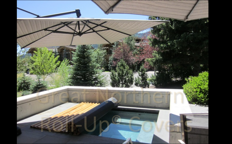 <p>Custom built Great Northern Western Red Cedar Roll-Up&reg; Cover on an inground gunite spa.</p>