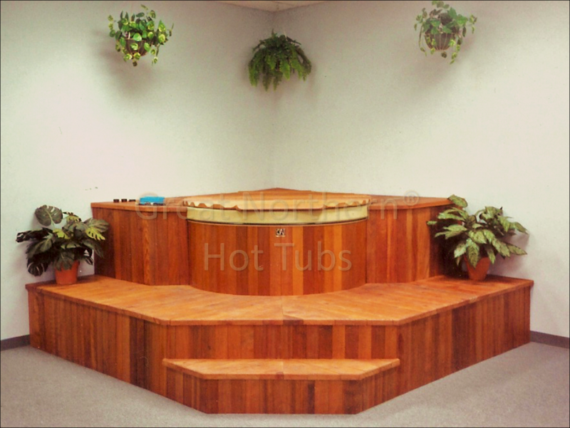 <p>Indoor round cedar hot tub built into large modular steps and seating.</p>