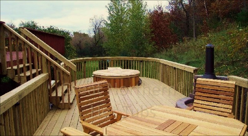 <p>Cedar hot tub added to an existing large backyard deck.</p>