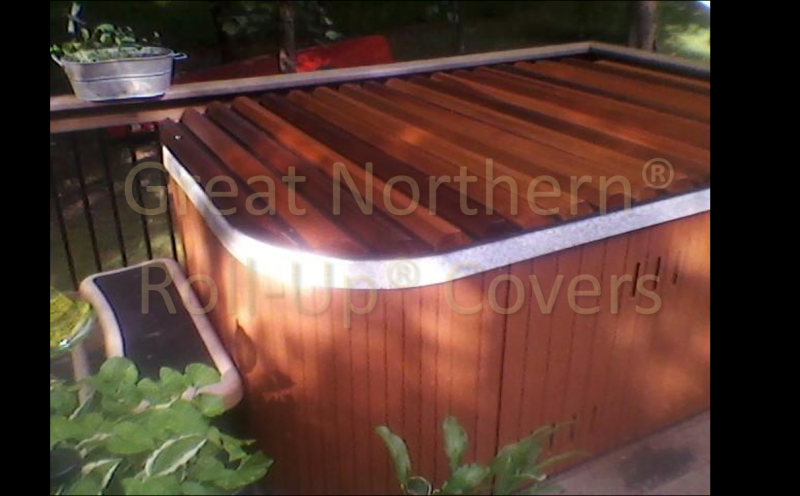 <p>Western Red Cedar Roll-Up&reg; cover with rounded corners on a rectangular molded jacuzzi spa</p>