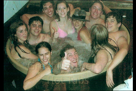 <p>Round hot tub 5 feet in diameter packed with ten teenagers.</p>
