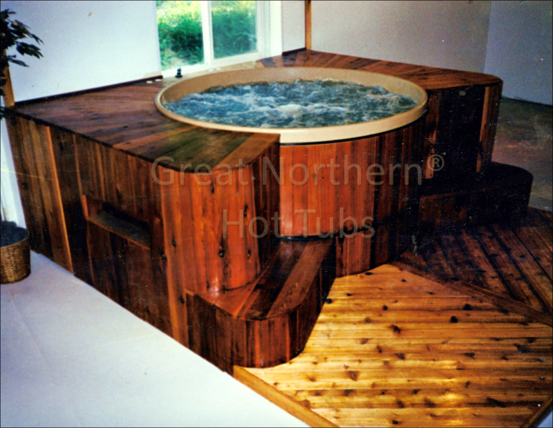 <p>  Indoor Great Northern® cedar barrel hot tub with decking and platform</p>