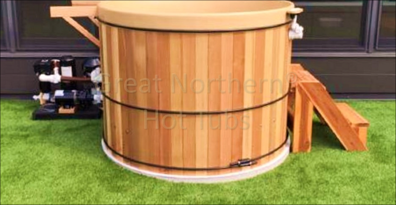 <p>Great Northern Rubadub Tub&reg; Hot Tub with steps, equipment pack and brackets for a Western Red Cedar Roll-Up Cover&reg; in process of installation outside a penthouse suite in Minneapolis, MN.</p>